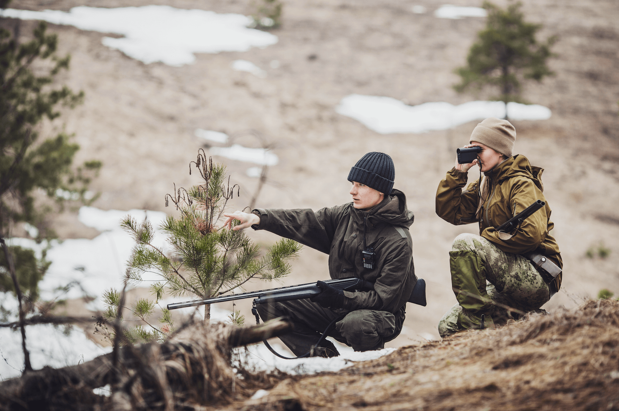 two people hunting with a rangefinder