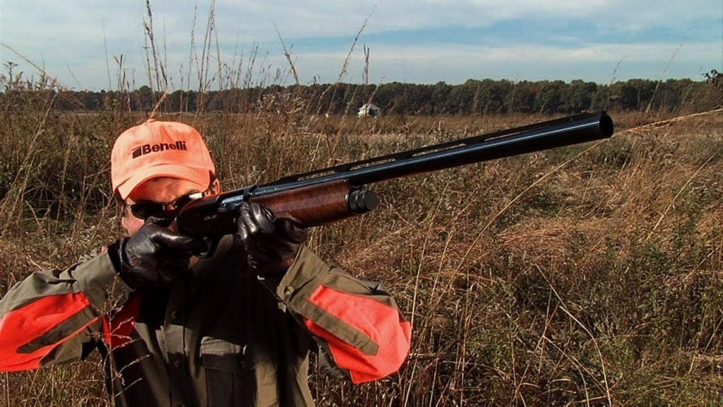 older hunter with benelli ultralight shotgun