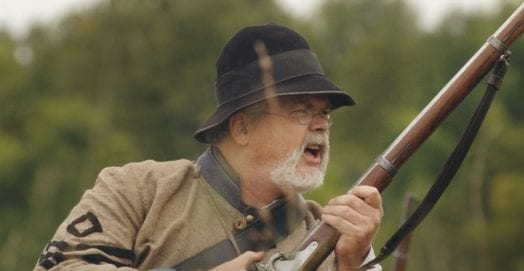 older shooter with musket